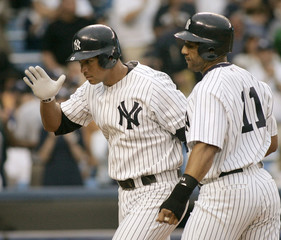 New York Yankees Rodriguez and Sheffield head for the dugout after home run against Cleveland Indians ...