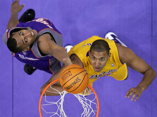 Suns' Diaw fights for rebound with Lakers' Cook during Game 3 of NBA Western Conference first round playoff series in Los Angeles