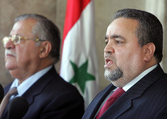Iraqi Parliament speaker al-Hassani speaks during news conference in Baghdad.
