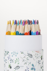 Abstract closeup of a box of colorful pencils.