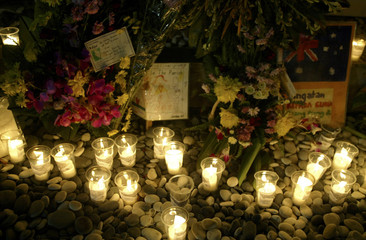 CANDLES ILLUMINATE WREATHS PLACED AT MEMORIAL FOR VICTIMS OF LASTYEAR'S BOMBINGS IN BALI.