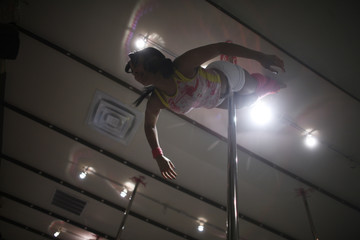 Diana Douglas helps to instruct an intermediate pole dancing class at Flirty Girl Fitness in Chicago