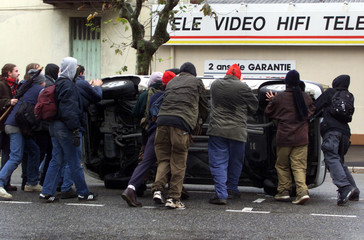 DEMONSTRATORS OVERTURN A CAR DURING VIOLENT INCIDENTS DURING THE EUROPEAN SUMMIT IN NICE.