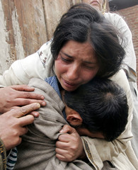 A relative of villager Mohamed Afzal cries during his funeral in Tral