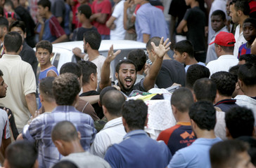 A Palestinian man shouts during a funeral in Gaza