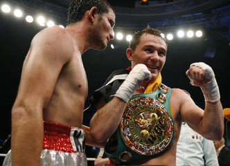 Tajbert celebrates victory over Gutierrez following WBC super featherweight interim world championship boxing fight in Kiel