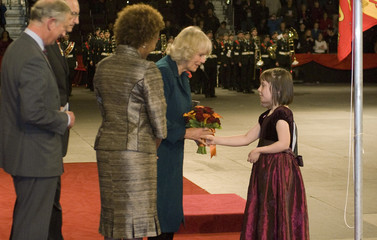 Camilla, Duchess of Cornwall, accepts flowers from a girl at the official welcoming ceremony in St. John's, Newfoundland