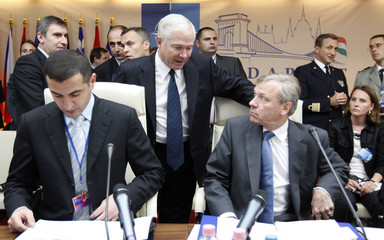 NATO Secretary-General Jaap de Hoop Scheffer talks with U.S. Defense Secretary Robert Gates during an informal meeting of NATO defence ministers in Budapes