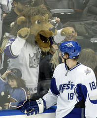 Western Conference player Perry from Anaheim Ducks looks at a mascot in Atlanta