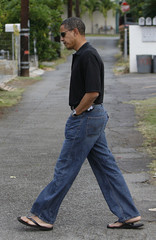 US Democratic presidential nominee Senator Barack Obama (D-IL) walks around the neighborhood after visiting his ailing grandmother in Honolulu