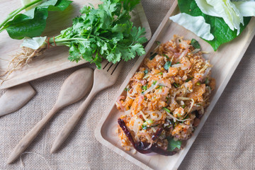 Spicy fermented rice salad (Yam Naem)