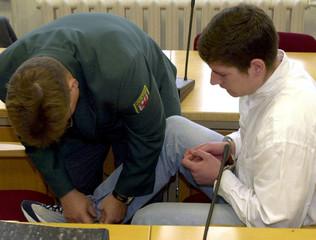 SUSPECTED MURDER STEFAN JAHN GETS LEG IRON REMOVED PRIOR TRIAL INFRANKFURT.