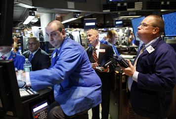 Trading specialists work on the floor of the New York Stock Exchange trading shares of Goldman Sachs