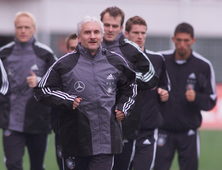 VOELLER, COACH OF GERMANY'S NATIONAL SOCCER TEAM, WATCHES HIS PLAYERS IN BUCHAREST.