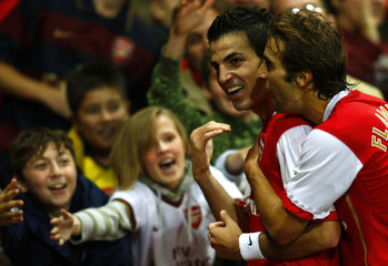 Arsenal's Cesc Fabregas celebrates after scoring against Sevilla during their Champions League soccer match in London