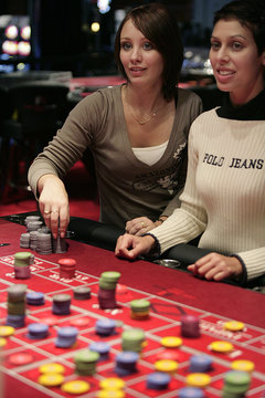 Gamblers play the roulette wheel at the new Casino Barriere in Toulouse