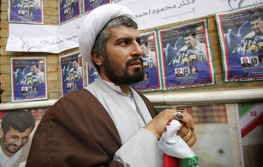 An Iranian cleric, a supporter of presidential candidate Mahmoud Ahmadinejad, attends an election campaign during a rally in front of Tehran's Sharif University
