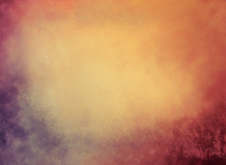 gold background with grunge borders and vintage texture in blue red orange and yellow with soft blur