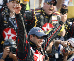 Montoya of Colombia celebrates after winning the NASCAR Busch series race in Mexico City
