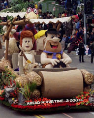 Cartoon characters Fred and Wilma Flintstone,along with their pet Dino, are featured on a float from..