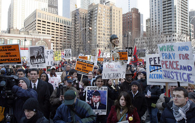 Demonstrators attend an anti-war protest in Chicago to mark the fourth anniversary of the Iraq war