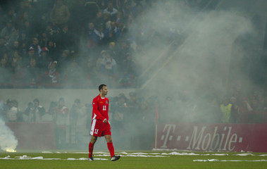 GIGGS OF WALES WAITS FOR FLARE SMOKE TO EVAPORATE DURING EURO 2004PLAYOFF IN MOSCOW.