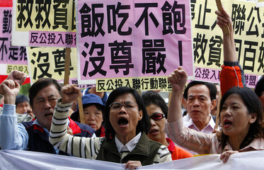 Opposition KMT supporters shout slogans during a protest outside the DPP headquarters in Taipei