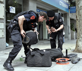 Policemen arrive at the scene of an explosion that struck a Citibank branch in Buenos Aires.