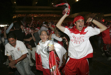 Sevilla's supporters celebrate their victory over Espanyol in Sevilla