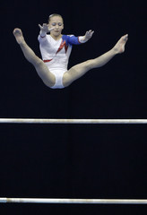 Russia's Semenova competes on the uneven bars during apparatus finals at the World cup in Artistic Gymnastics in Moscow