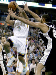 New Orleans Hornets guard Chris Paul shoots over San Antonio defender Tim Duncan during the second half of their NBA basketball game in New Orleans