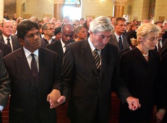 BERTRAND RAMCHARAN, RUUD LUBBERS AND NANE ANNAN HOLD HANDS DURINGFUNERAL CERMEONY FOR SERGIO ...