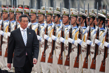 Singapore's PM Lee reviews honour guard in Beijing