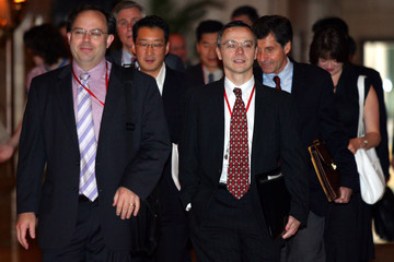 Members of the US six-party talks delegation walk at a hotel in Beijing.