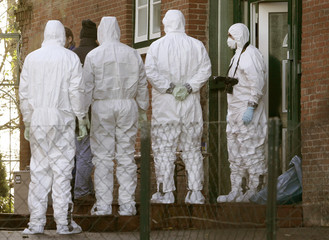 Experts in protective suits inspect the house of the former mother-in-law of Russian businessman Kovtun in Haselau near Hamburg