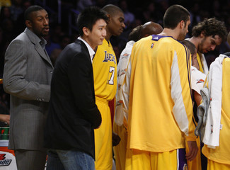 Los Angeles Lakers' Sun Yue of China stands with teammates during NBA basketball game in Los Angeles