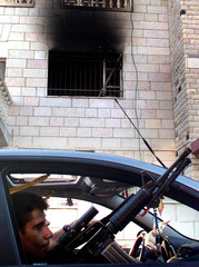 Al Aqsa Martyrs Brigades leader Zubeidi passes by government building he set fire to in Jenin.