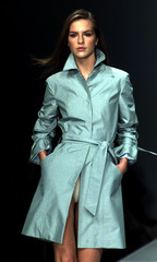 A model wears an overcoat as part of Byblos Spring/Summer ready-to-wear women's collection 2001 in M..