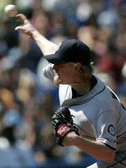 Seattle Mariners pitcher Jeff Weaver throws to the Toronto Blue Jays in Toronto