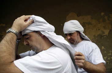 Costaleros get ready for a Holy Week procession in Madrid