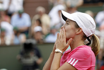 Belgium's Justine Henin blows a kiss after defeating Serbia's Ana Ivanovic in the women's final match at the French Open tennis tournament at Roland Garros in Paris