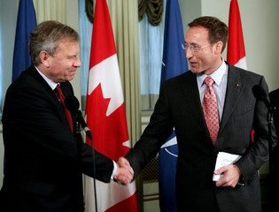 NATO Secretary General Jaap de Hoop Scheffer shakes hands with Canada's Foreign Minister Peter MacKay in Ottawa