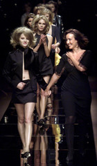Designer Nathalie Gervais (R) appears with her models at the end of her Spring/Summer 2001 ready to ..