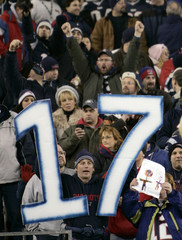 A New England Patriots fan holds a 17 sign, hoping for the Patriots' seventeenth victory this season as they met the Jacksonville Jaguars in their AFC Divisional NFL playoff game in Foxborough