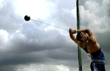 Argentine Juan Cerra competes in the men's hammer throw final against a stormy sky at the XIV Pan Am..