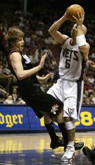 Philadelphia 76ers Korver fouls New Jersey Nets Kidd.