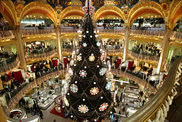 GIANT CHRISTAMS TREE SET UP AS HOLIDAY DECORATIONS AT GALERIESLAFAYETTE DEPARTMENT STORE IN PARIS.