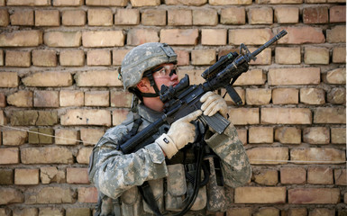 A U.S. soldier of Charlie company, 2nd Battalion, 16th Infantry Regiment takes position during a patrol at the area known as New Baghdad