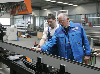 EU commissioner for enterprise and industry Verheugen poses in Rietz