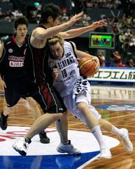New Zealand's Boucher drives to basket past Japan's Amino at world basketball championships in Hiroshima